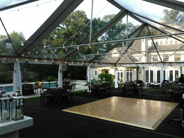 Dance floor under a clear top tent in Barrington, 60021